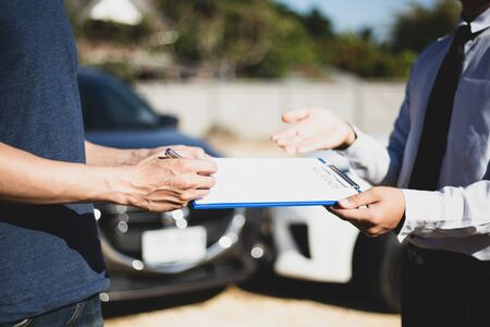 Customers and car insurance agents have entered into agreements and signed documents to claim compensation after a car crash, Insurance concept. Reklamní fotografie