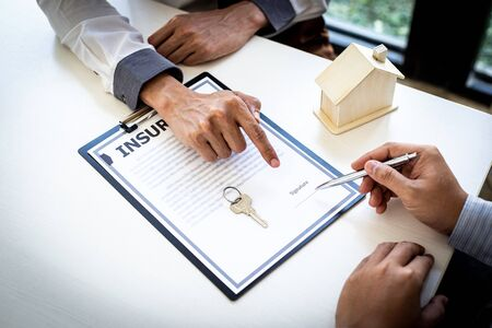 Home insurance agents offer terms and conditions to clients and get approval, home purchase and insurance contracts, Real estate investment of Concept