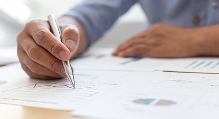 Businessmen analyze market data and calculate the cost of buying-selling products for a client's company, Professional marketing and financial accountants concept.