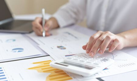 Accounting businessmen are calculating income-expenditure and analyzing real estate investment data, Financial and tax systems concept.