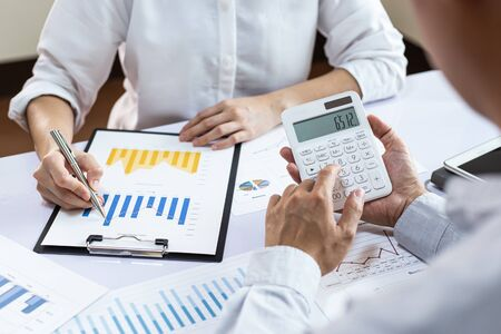 The team leader and the company's finance department are meeting and analyze the market data with a bar chart, Financial management for tax and accounting systems concept.