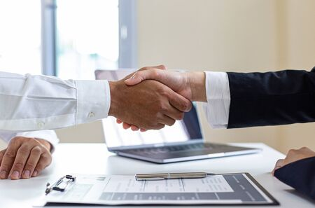 Employer or HR department welcomes new employees, Shaking hands with congratulations or achieving business and income success, Hand shak concept.