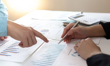 Businessman and financial team are analyzing the results of operations and calculating the company's revenue and expenses in order to prepare for management proposals, Financial and Accounting Team Meetings concept.