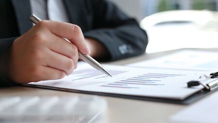 Financial businessmen analyze the graph of the company's performance to create profits and growth, Market research reports and income statistics, Financial and Accounting concept. Stock Photo