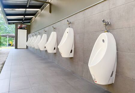 Men's white urinals design, Close up row of outdoor urinals men public toilet, Urinal concept.