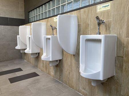 Men's white urinals design, Close up row of outdoor urinals men public toilet, Urinal concept.