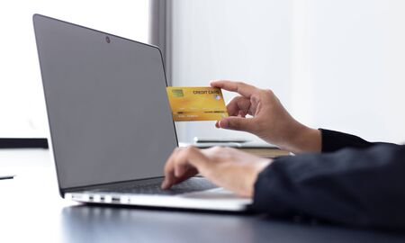 women use laptop to register online purchases using credit card payments, Convenience in the world of technology and the internet, Shopping online and banking online concept.