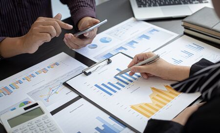 Business team meeting present, Businessmen and investors are brainstorming and analyzing annual revenue data graphs to present their work to financial managers, Financial accounting, Tex