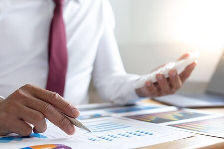 Accounting businessman are calculating income-expenditure and analyzing real estate investment data, Dedicated to the progress and growth of the company, Financial and tax systems concept.