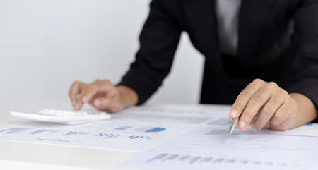 Accounting businessmen are calculating income-expenditure and analyzing real estate investment data, Dedicated to the progress and growth of the company, Financial and tax systems concept.
