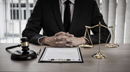 Judge or a lawyer works documents in the courtroom and analyze the various laws for justice and accuracy, Litigation and justice concept.