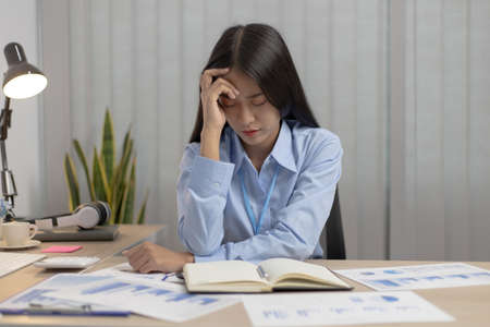 Asian female staffers are disappointed by the mistakes made,Despair or disappointment, Failure of life concept.