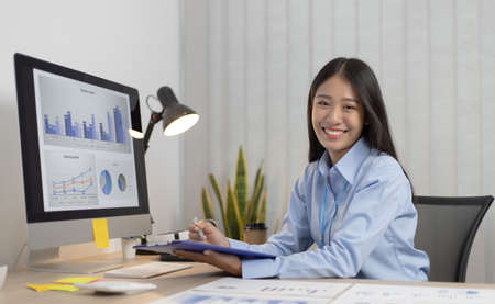 Happy business people,Asian female employee works in the company's financial auditing with a smiling face, Employees with good attitude and good-natured. Stock fotó