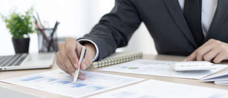 Financial businesswomen analyze the graph of the company's performance to create profits and growth, Market research reports and income statistics, Financial and Accounting concept. 写真素材