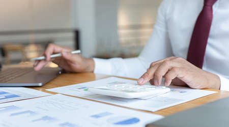 Financial businessman analyze the graph of the company's performance to create profits and growth, Market research reports and income statistics, Financial and Accounting concept.