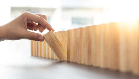 Strategies and risks of wooden games, Close-up of business people gambling with investment risk, Business people play wooden games to simulate planning and strategy for managing business risk.
