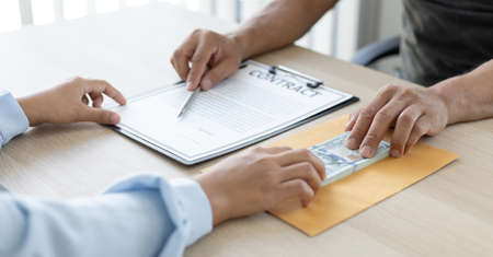 Businessmen give money dollar bribe employees sign consent documents for illegal loans, Bad plan, corruption concept. Stockfoto