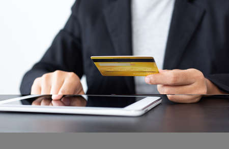 women use Tablet to register online purchases using credit card payments, Convenience in the world of technology and the internet, Shopping online and banking online concept.