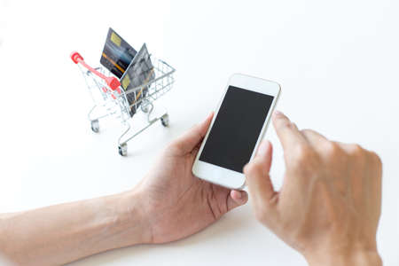 Men use smart phone to register online purchases using credit card payments, Convenience in the world of technology and the internet, Shopping online and banking online concept.