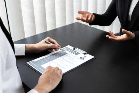 HR head is reading the resume and information about the candidate's history, Field employers are interviewing job applicants and negotiating agreements, Recruitment and job applications concept.
