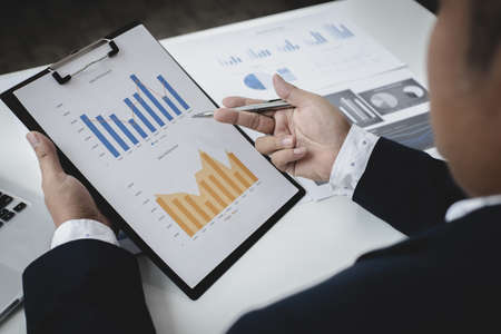 Head of marketing has analyzed the financial income graph of the company in order to develop the structure of the company to be ready for the economy in the future. Financial results analysis concept.