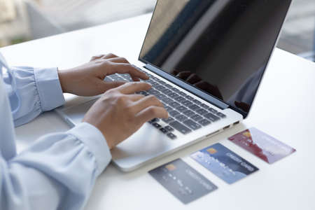Women use laptop register via credit cards to make online purchases, Using the Internet in Online Marketing and Trading, Online shopping or Internet technology concept.
