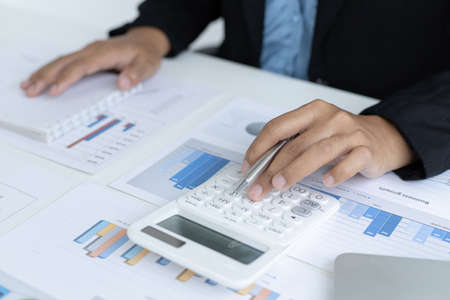 Accounting businesswomen are calculating income-expenditure and analyzing real estate investment data, Dedicated to the progress and growth of the company, Financial and tax systems concept.