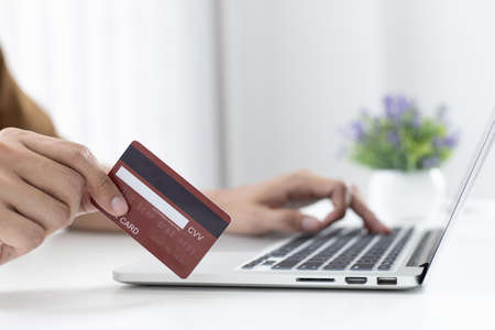 Men use laptop to register online purchases using credit card payments, Convenience in the world of technology and the internet, Shopping online and banking online concept. Stock Photo