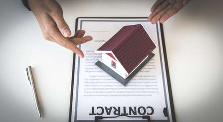 Sales manager or real estate agent will be prepared to show you a sample home and detail the terms of buying a home with insurance promotions, Attention to property services and insurance concept.