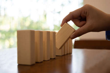 Strategies and risks of wooden games, Close-up of business people gambling with investment risk, Business people play wooden games to simulate planning and strategy for managing business risk. Foto de archivo