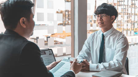 Employer or HR department is reading the resume and interviewing the ability of new employees, Employer is selecting job applicants, Employment and Recruitment Concept.