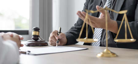 Attorney or judge provides legal advice to the client in the courtroom, Ethics in the courts include justice and impartiality, legal consultant, scales of justice, law hammer, Litigation and justice. Stock Photo