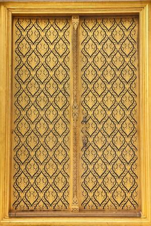 Native Thai style of pattern on door temple photo