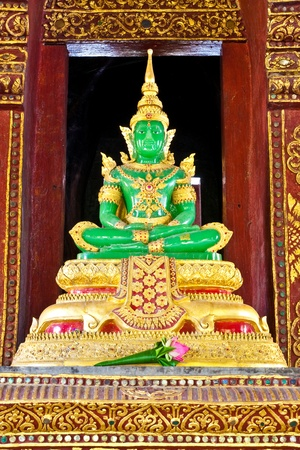 The Emerald Buddha Mock from the temple of Wat Phra Kaeo at the Grand Palace in Bangkok, Thailand.  This photo from Wat Phrasing, Chiangmai, Thailand Stock Photo