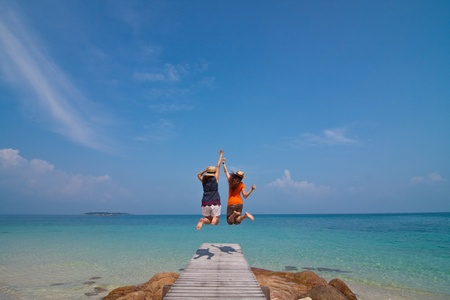 Jumping on the beach, Munnork Island, Rayong Province, Gulf of Thailand Stock Photo
