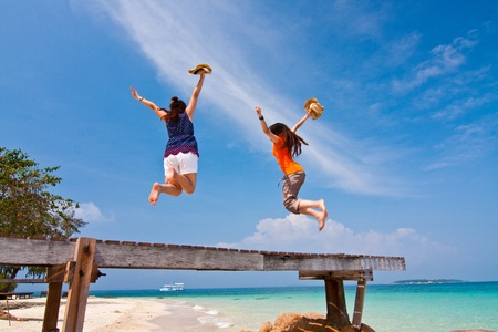 The jumping in happiness holidays on the sea, Thailand Stock Photo