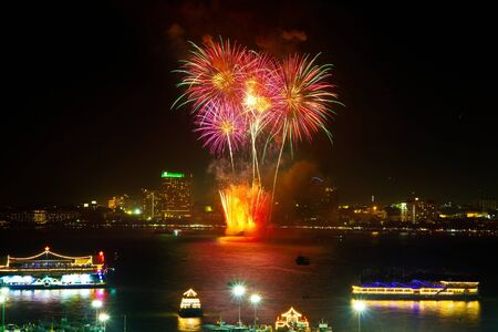 Fireworks with reflections at Pattaya Gulf, Chonburi Province, Thailand Stock Photo