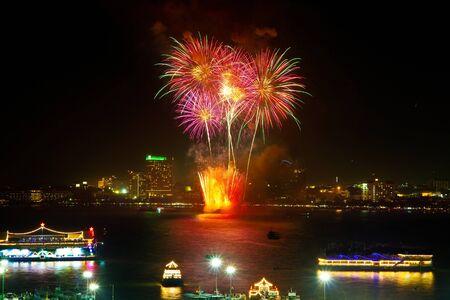Fireworks with reflections at Pattaya Gulf, Chonburi Province, Thailand Stock Photo