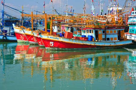 Colorful many fishing thai boats, thailand photo