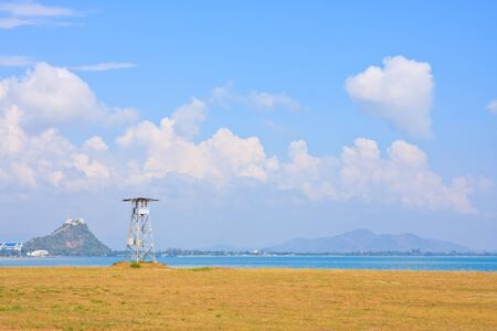Wooden life guard tower on  the sea and the blue sky, Thailand Stock Photo
