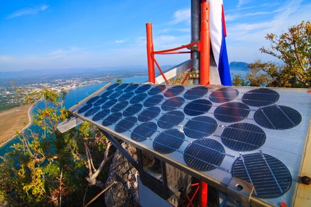 Blue solar batter cells and awesome mountain seascape as a background. Phajoupkirikun Gulf, Thailand Stock Photo