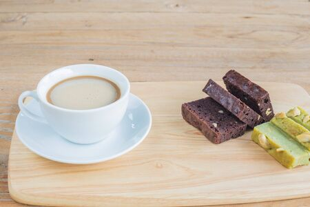 dring: Coffee with white cup and brownie cake on the wooden background Stock Photo