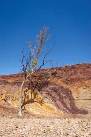 Ocher mine, used by aboriginal Australian as raw material for paintings and ceremonial body decoration. Vertical picture. Ocher Pits, MacDonnell ranges, Northern Territory NT, Australia, Oceania