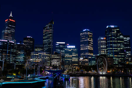 City skyline of the commercial business district CBD at night. Neon lights and office buildings skyscrapers. Perth capital city of West Australia WA, Australia