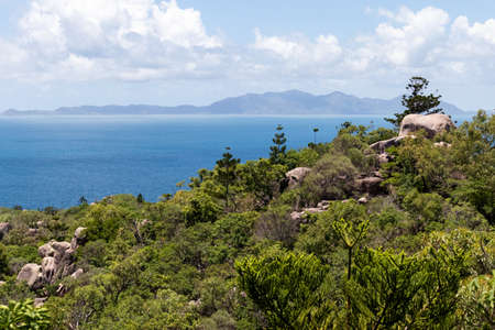Views of the ocean from The Forts trail, dense vegetation, mountains at the horizon, Magnetic Island, Queensland, Australia Stock fotó