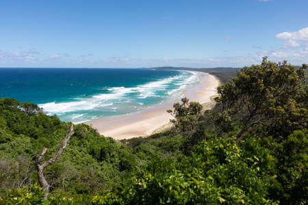 The perfect bay Tallow Beach at Byron Bay, picture taken from the walking path to the lighthouse at Byron Cape. Byron bay, New South Wales NSW, Australia, Oceania