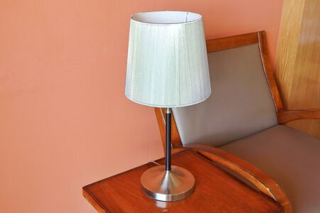 A lamp and wood chair