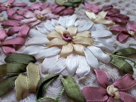 Ribbon embroidery - multicolored flowers on a textured fabric. Idea for decoration and design of clothing, home textiles, tablecloths. Hand made. idea for a hobby, household
