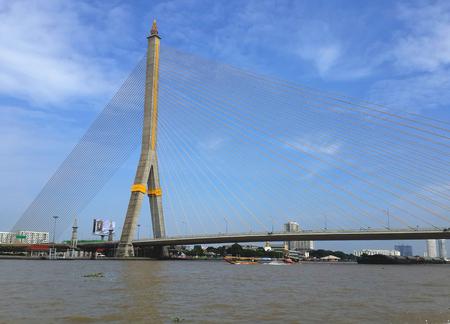 chao praya: The Rama VIII Bridge Bangkok Thailand and the Chao Praya river, full view with nice blue sky. Editorial