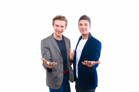 two person only: Two handsome young men isolated on white and smile